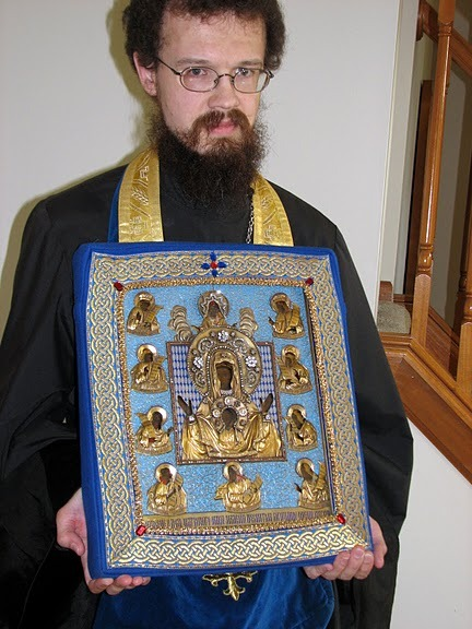 Priest Paul Akmolin